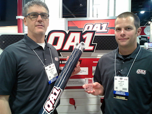 Travis Gorsuch, QA1's Director of Advanced Materials (L) and QA1's Dave Knauff (R) pose with the company's SEMA award winning carbon fiber driveshaft.