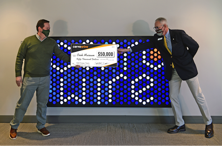 (L to R) Cerrowire President Stewart Smallwood presents a check for $50,000 to Cook Museum Executive Director Scott Mayo.
