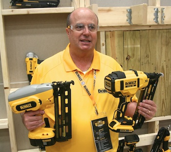 Product Manager Jorge Silveira shows off the size difference between previous (left) and new generation nailers (right).