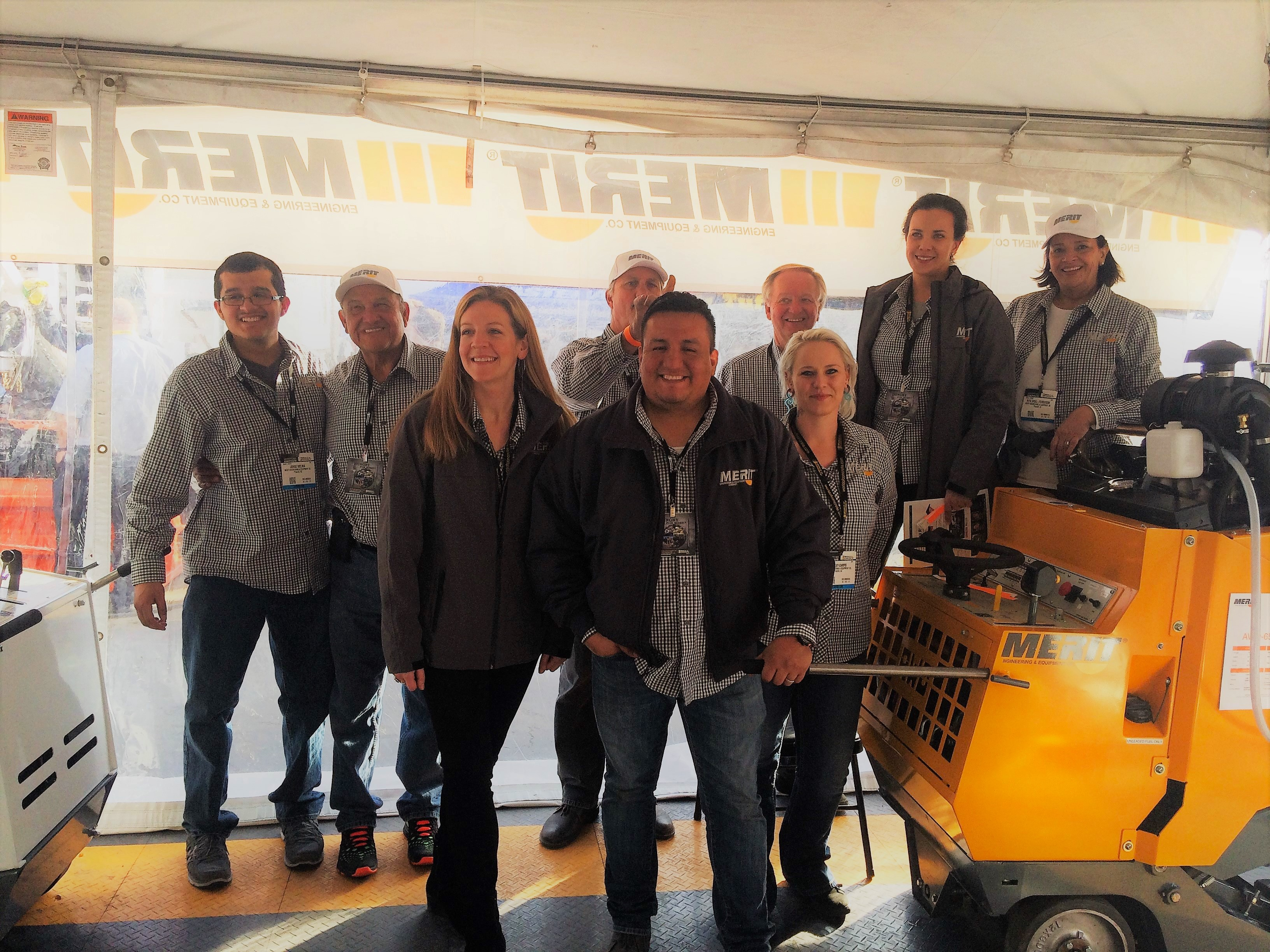 Merit Saw staff and distributors pose at Merit's outdoor booth at the 2017 World of Concrete Show.