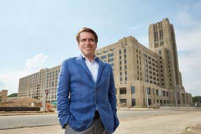 nexair CEO Kevin McEniry stands in front of Crosstown Concourse, the historic former Sears & Roebuck building in downtown Memphis, which will become nexair's new headquarters in 2017. nexair will occupy 33,000 square feet of the 1.1 million square foot mixed-use building, which was vacant for 20 years before a $200 million renovation project gave it new life.