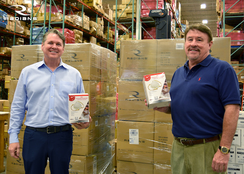 Radians president Bill England (left) and CEO Mike Tudor (right) pose with the company's donation of 14,000 N95 masks to help Memphis' first responders and health care front-line professionals combat COVID-19.