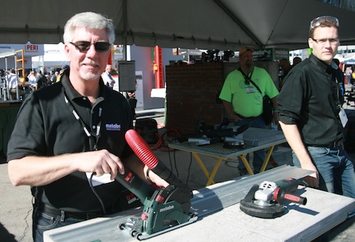 Metabo's Terry Tuerk (L) demonstrates the company's W12-125 HD CED and W12-125 HD CED Plus systems, which create a track saw system for concrete.