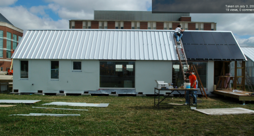 Students apply solar panels to the award-winning super-insulated Gable Home on the campus of the University of Illinois, Urbana-Champaign.