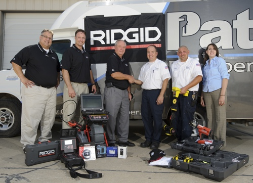 RIDGID team consisting of (from left to right) Dan Klug, Owen Primavera, and Cliff Wells. Followed by the owner of Pat the Plumber, Pat Grogan, followed by Clayton Bevitt and Kylie Mason.
