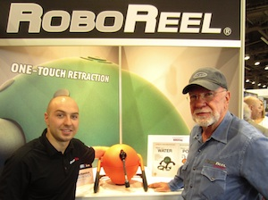 John Tracey (L), director of business operations for Great Stuff, Inc., showed off the RoboReel motorized cord and hose reel system. It was invented by John's father, Jim Tracey (R), who was also working the booth.