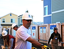 Mike Bugbee, senior vice president for Simpson Strong-Tie, works on a home in Oakland, Calif., during a corporate volunteer day. Simpson Strong-Tie has renewed its partnership with Habitat for Humanity for a sixth year.