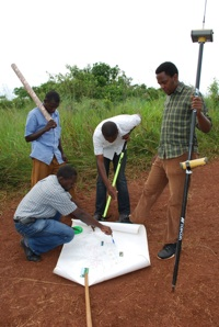 A Watoto engineering and construction crew locates the property boundary for Suubi village with the aid of a HiPer GA GPS+ receiver from Topcon Positioning Systems.