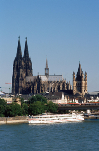 Just across the Rhine from the Cologne Convention Center beckons the old town district of Cologne, anchored by the city's iconic thousand-year-old cathedral. Cologne is one of the top cultural and shopping destinations in Europe. In addition to countless land-based hotels, the ship in the foreground of this photo is a floating hotel, a number of which ply the Rhine serving tourists and trade show attendees.