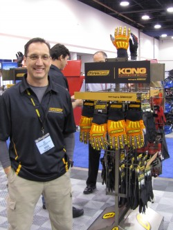 Eric Jaeger, VP of research and development for Ironclad Performance Wear, poses at the National Hardware Show with a display of his company's KONG glove, which has won a special award from the US Department of the Interior's Minerals Management Service (MMS) for exceptional performance in enhancing worker safety. Jaeger worked with the MMS for more than 18 months to design and develop the KONG work glove specifically for the oil & gas industry.