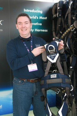 Super snug! Capital Safety's Jeff Halbach points out some of the comfort and safety features of the new top-of-the-line ExoFit NEX full-body harness system.