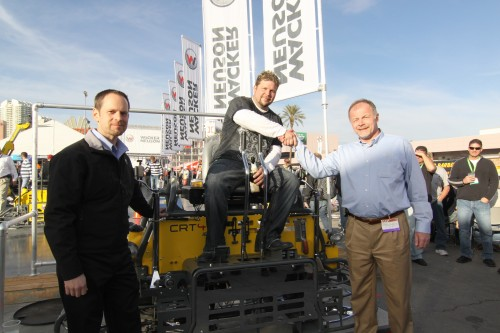 Lee Hadenfeldt, winner of Wacker Neuson's 2010 TROWEL CHALLENGETM competition at the World of Concrete, celebrates his victory on his new customized CRT 48-35VX ride-on trowel powered by a special VanguardTM BIG BLOCKTM V-twin engine.  Celebrating with Hadenfeldt is Dan Roche (left), marketing manager-commercial power at Briggs & Stratton, and Johannes Schulze Vohren, vice president of sale and product support for Wacker Neuson Corporation